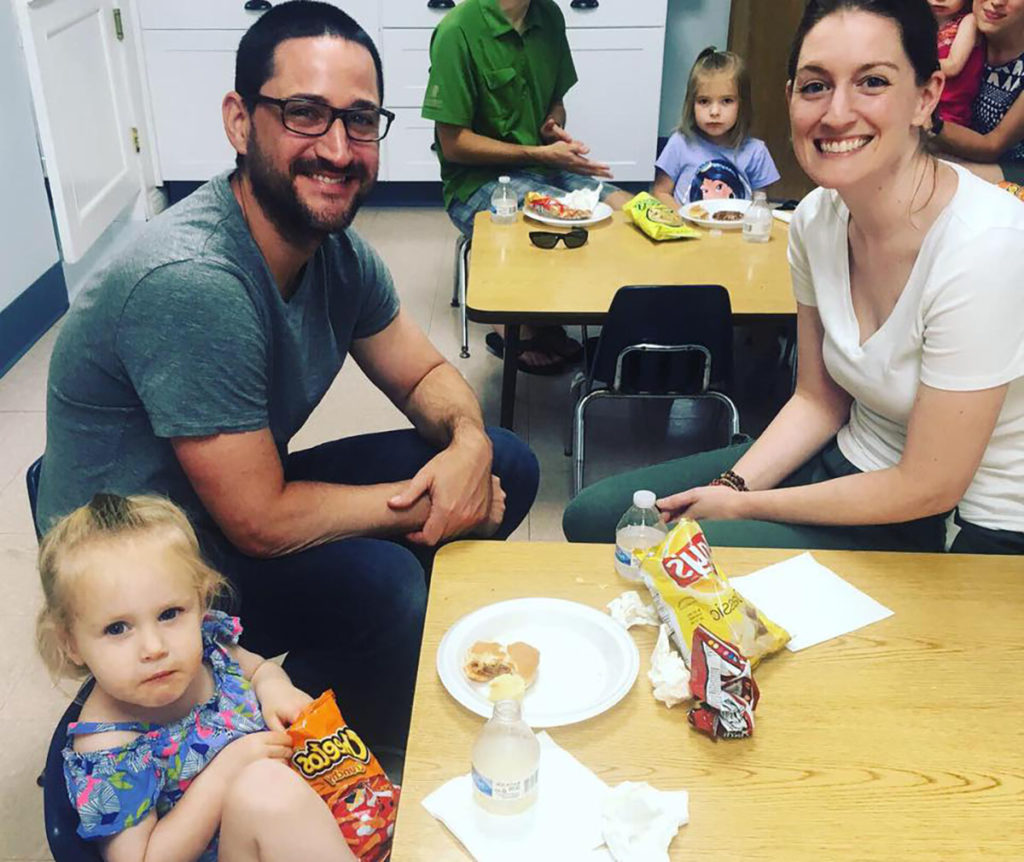 cute toddler with parents at a Preschool & Daycare Serving Carmel, Indiana