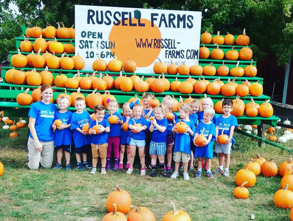 happy children at pumpkin farm at a Preschool & Daycare Serving Carmel, Indiana