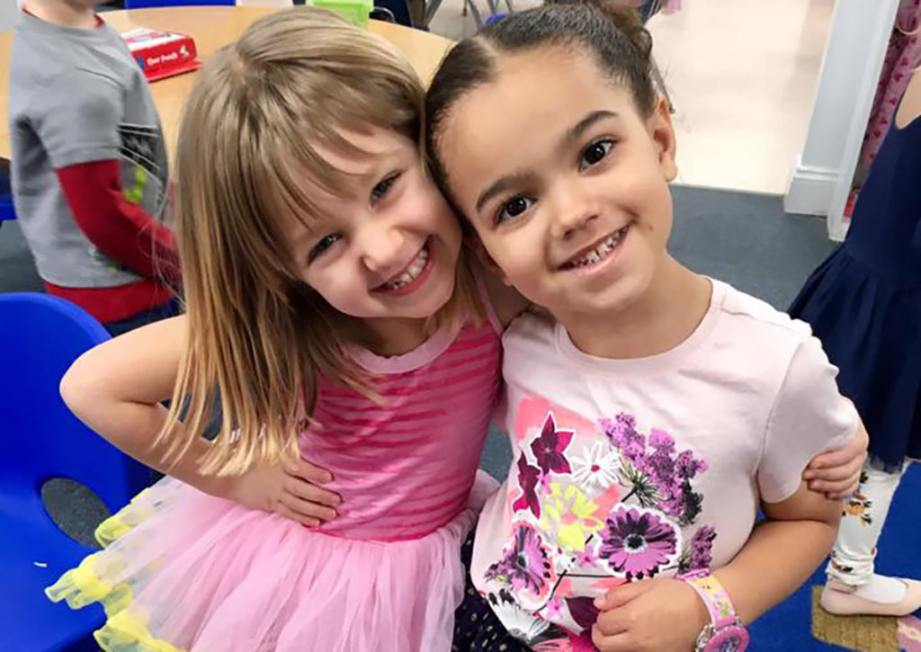 two smiling friends at a Preschool & Daycare Serving Carmel, Indiana