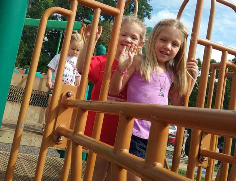 Kindergarten children on playground at a Preschool & Daycare Serving Carmel, Indiana