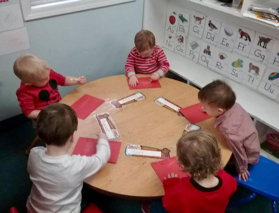 children seating at a table learning at a Preschool & Daycare Serving Carmel, Indiana