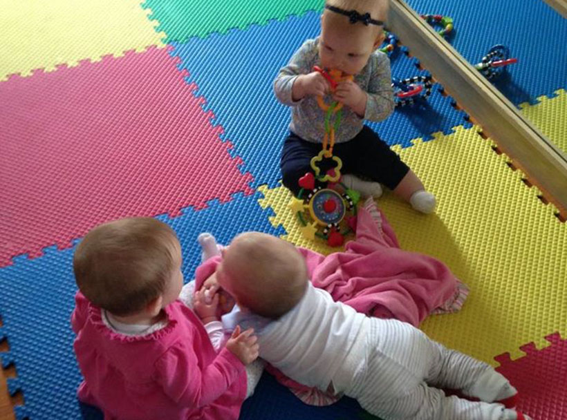happy infants playing together on mats at a Preschool & Daycare Serving Carmel, Indiana