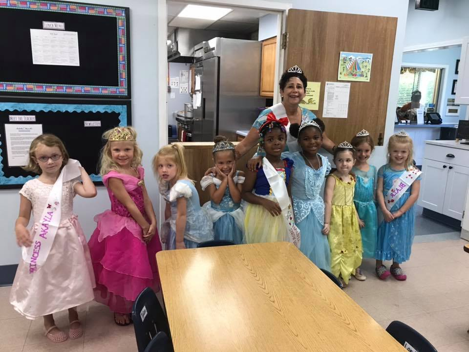 happy kindergarten girls in costume at a Preschool & Daycare Serving Carmel, Indiana