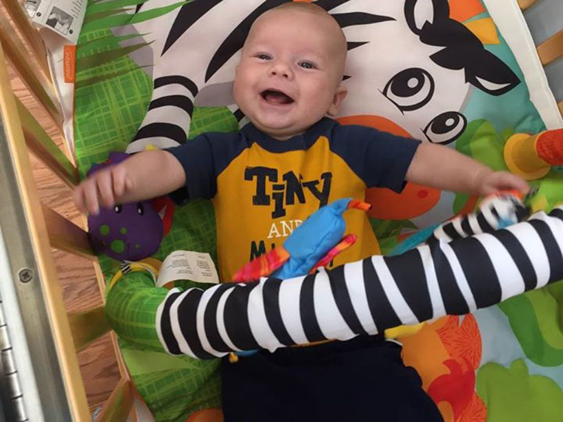 happy laughing baby at a Preschool & Daycare Serving Carmel, Indiana
