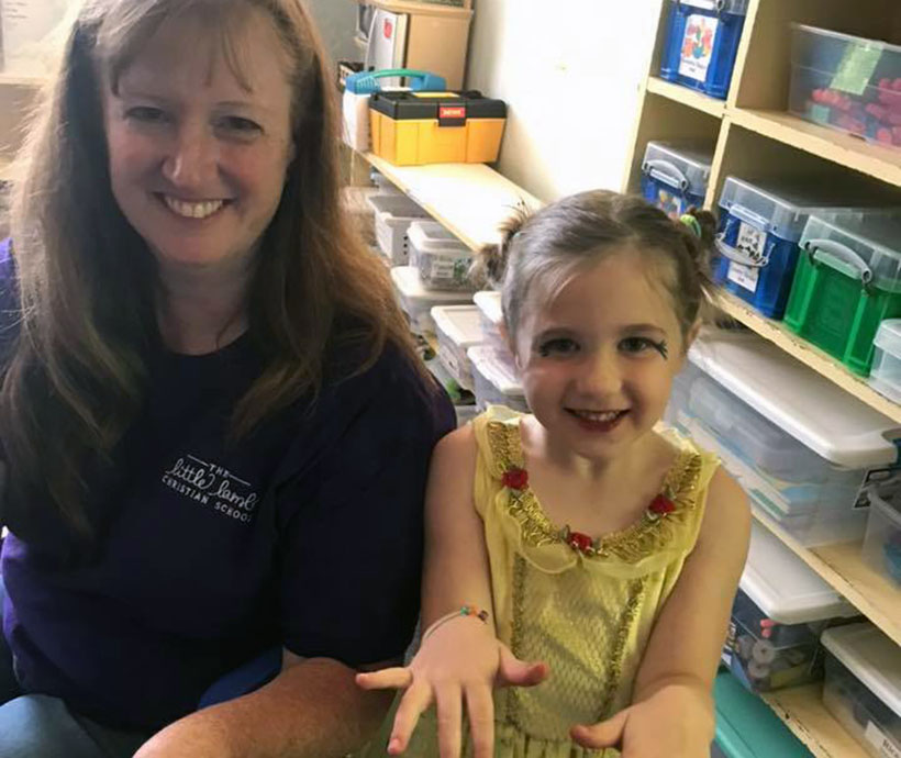 happy smiling teacher & girl at a Preschool & Daycare Serving Carmel, Indiana