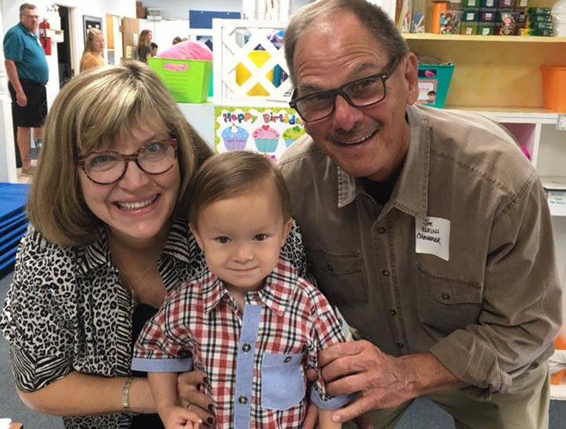 happy toddler with parents at a Preschool & Daycare Serving Carmel, Indiana