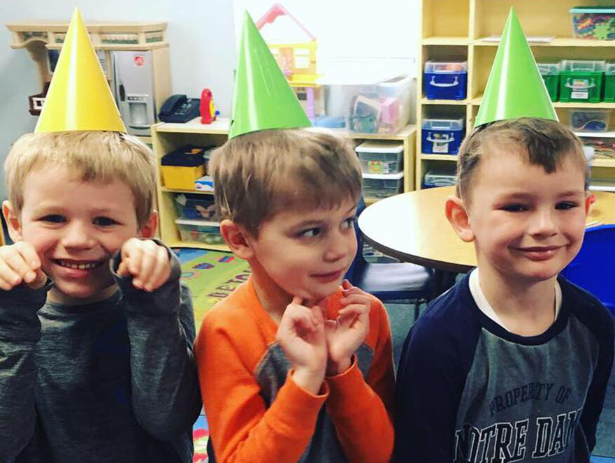 kindergarten boys with party hats at a Preschool & Daycare Serving Carmel, Indiana