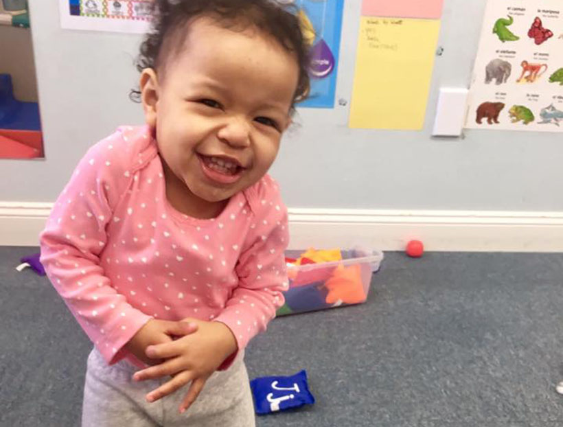 laughing toddler at a Preschool & Daycare Serving Carmel, Indiana