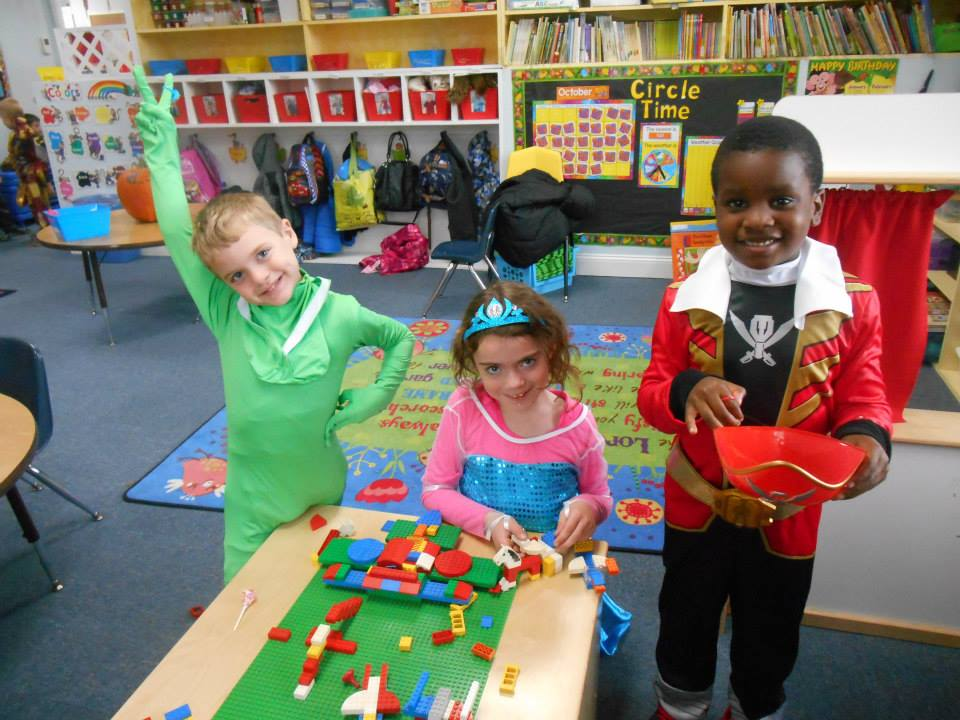 smiling pre k children in costume at a Preschool & Daycare Serving Carmel, Indiana