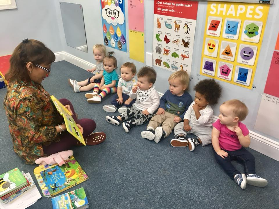 teacher reading to toddlers at a Preschool & Daycare Serving Carmel, Indiana