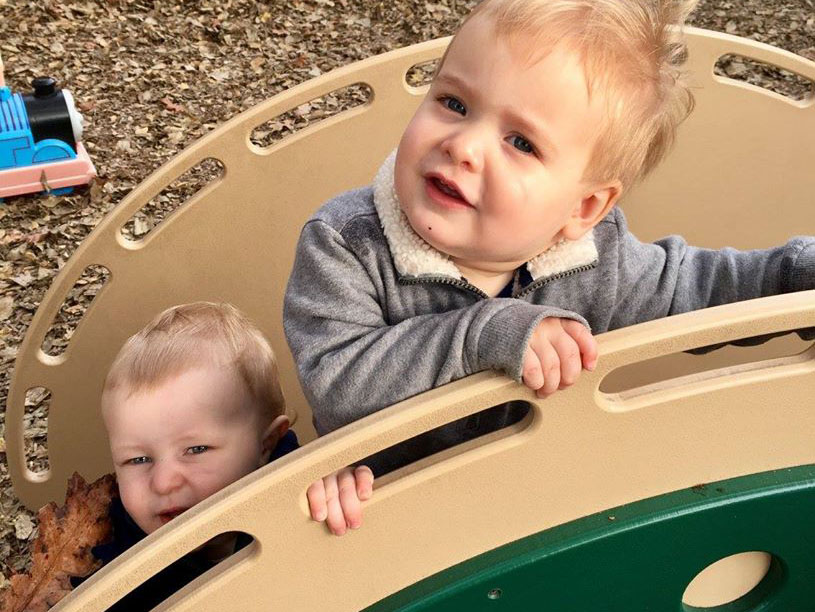 toddlers climbing bridge outdoor at a Preschool & Daycare Serving Carmel, Indiana