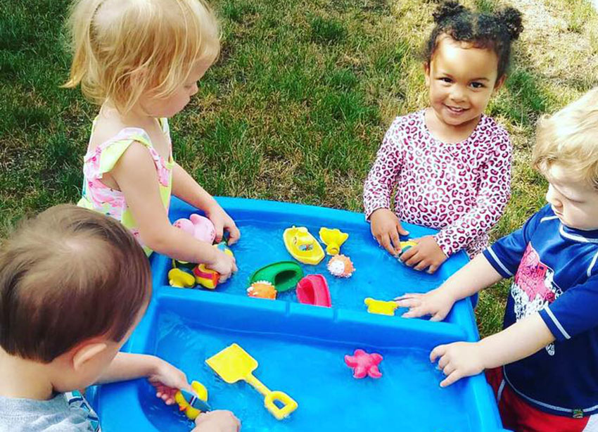 toddlers playing outdoor at a Preschool & Daycare Serving Carmel, Indiana