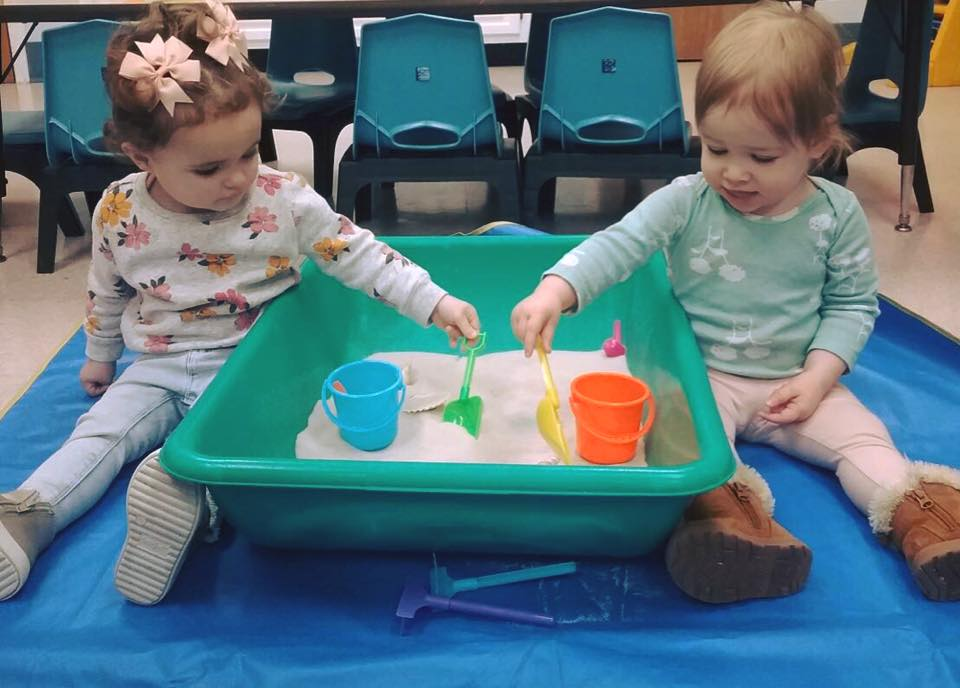 toddlers playing with sandbox at a Preschool & Daycare Serving Carmel, Indiana